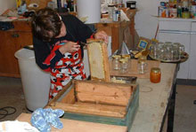 Yougster extracting his first Honey crop